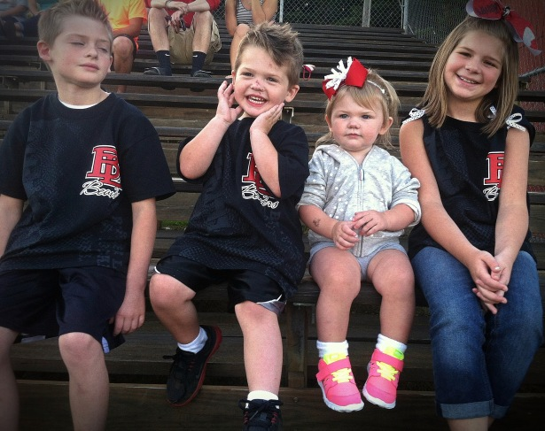 Cheering on the Beavers and a great example of trying to capture all 4 kiddos at once .
